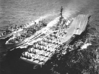 USS Hornet (CVA-12), circa 1957, during an UNREP with USS Castor (AKS-1) and an unidentified destroyer.