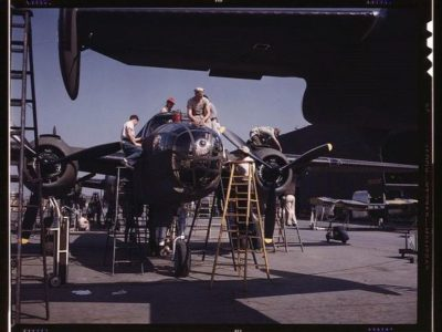 """Employees on the """"Sunshine"""" assembly line at North American's plant, put the finishing touches on another B-25 bomber, Inglewood, Calif. In addition to the battle-tested B-25 (""""Billy Mitchell"""") bomber used in General Doolittle's raid on Tokyo."""