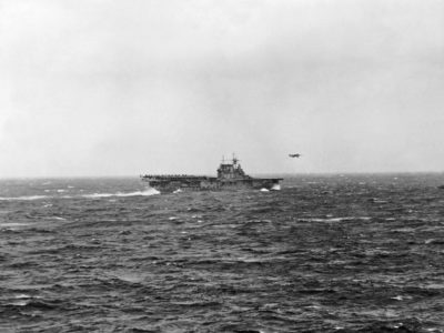 A North American B-25 Mitchell of US Army Air Corps 17th Bomb Group (Medium) is airborne from the flight deck of USS Hornet (CV-8) for the first aerial attack on Japan. Photograph taken from USS Enterprise (CV-6).