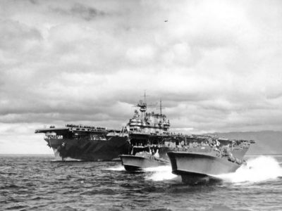 P. T. Boats escort USS Hornet (CV-8) departing Pearl Harbor following Hornets return to Pearl Harbor on 25 April, 1941 returning from the Doolittle Tokyo Raid.
