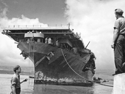 Hornet moored at Ford Island, Pearl Harbor, following deployment with Task Force 17 to the Battle of the Coral Sea. Note the hull paint condition following two campaigns. May 27th, 1942.