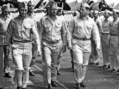 RADM. Joseph J. Clark, USN (center) CAPT. William D. Sample, USN (starboard) and CDR. C. H. Duarfield, USN at inspection of crew aboard USS Hornet (CV-12).