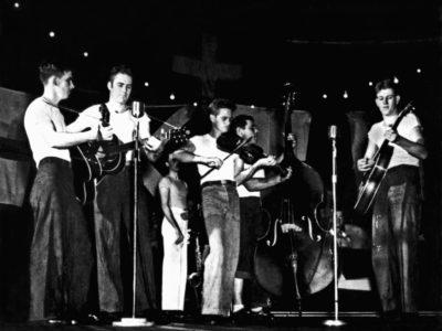 """Hangar Bay Stage"" Christmas entertainment by a group of Hornet   musicians. L/R Otis Gettings, Coffee, Furman Walker, Buck Redman, and James Harris."