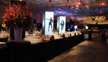 The Hangar Deck is transformed with dramatic lighting and thematic accents.